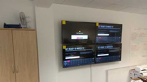 4 LG TVs Mounted in a grid formation